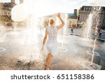 girl in a spray of water in a... | Shutterstock . vector #651158386