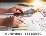 human works on calculator.   Shutterstock . vector #651160990