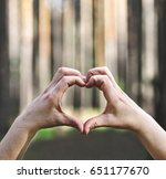 hands in shape of love heart on ... | Shutterstock . vector #651177670