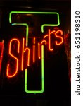 tshirts neon sign hanging in a... | Shutterstock . vector #651198310