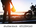 silhouette of biker and...