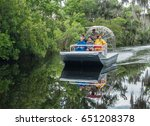 Small photo of New Orleans, Louisiana - May 22, 2017; A group of people take an airboat swamp tour, a popular attraction of tourists to the area to enjoy the scenery and wildlife, including numerous alligators.