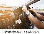 male hands on steering wheel on ... | Shutterstock . vector #651306178