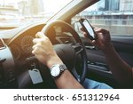 man driving while using... | Shutterstock . vector #651312964