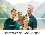family of four outdoors | Shutterstock . vector #651337864