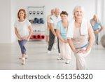 elderly people exercising in a... | Shutterstock . vector #651356320