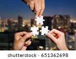 three hands holding piece of...   Shutterstock . vector #651362698