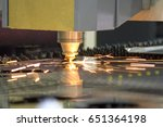 Small photo of CNC laser cut machine while cutting the sheet metalCNC laser cut machine while cutting the sheet metal