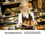 beautiful female bakery posing... | Shutterstock . vector #651392410