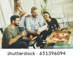 group of young people eating... | Shutterstock . vector #651396094