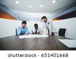 three business people in... | Shutterstock . vector #651401668