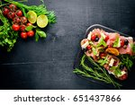 bruschetta with meat  olives ... | Shutterstock . vector #651437866