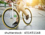 legs of man and bike wheels on... | Shutterstock . vector #651451168
