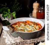 baked stuffed conchiglioni with ... | Shutterstock . vector #651451609