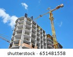 crane and building under... | Shutterstock . vector #651481558