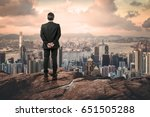 businessman looking the city up ... | Shutterstock . vector #651505288