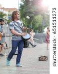 street drummer plays percussion ... | Shutterstock . vector #651511273