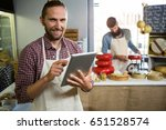 portrait of smiling staff using ... | Shutterstock . vector #651528574