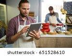 attentive staff using digital... | Shutterstock . vector #651528610