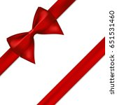 red satin ribbon with bow on... | Shutterstock .eps vector #651531460