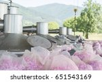 Stock photo rose oil extraction with technology rose oil to extract rose oil roses before extracting 651543169