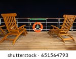 Empty deckchairs on the ship's deck - stock photo