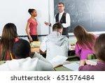 positive senior man giving a...   Shutterstock . vector #651576484