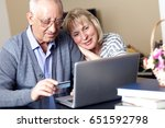senior couple  with laptop ... | Shutterstock . vector #651592798