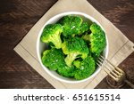 a bowl of cooked green broccoli ... | Shutterstock . vector #651615514
