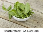 spinach in a white bowl on a...   Shutterstock . vector #651621208