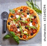 pizza with dry cured ham and...   Shutterstock . vector #651640294