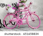 Small photo of pink bicycle with flowers, centenary of giro italia symbol