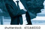 elegant man taking a gun from... | Shutterstock . vector #651660310