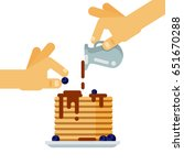 hands pouring chocolate syrup... | Shutterstock .eps vector #651670288