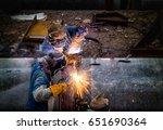 welder is welding big pipe at... | Shutterstock . vector #651690364