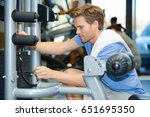 man positioning pin to select... | Shutterstock . vector #651695350