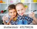 children drink milk | Shutterstock . vector #651708136
