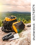 orange backpack lying on a... | Shutterstock . vector #651743974