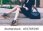 girl sitting on the stairs with ... | Shutterstock . vector #651769240