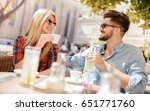 flirting in a cafe. beautiful... | Shutterstock . vector #651771760
