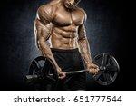 brutal strong athletic men... | Shutterstock . vector #651777544