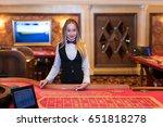 cute lady casino dealer at... | Shutterstock . vector #651818278