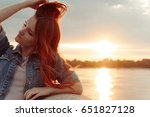 red haired woman touch her long ... | Shutterstock . vector #651827128