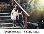 fashionable boy in black... | Shutterstock . vector #651827368