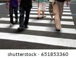 pedestrian crossing road during ... | Shutterstock . vector #651853360