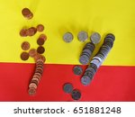 Small photo of Copper and silver coins flux runs across the line between the yellow area and the red area,Business and finance