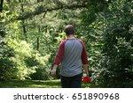 person walking in the woods | Shutterstock . vector #651890968