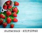 ripe juicy strawberries on a... | Shutterstock . vector #651910960