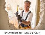 adult senior worker builder... | Shutterstock . vector #651917374