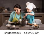 happy family in the kitchen.... | Shutterstock . vector #651930124